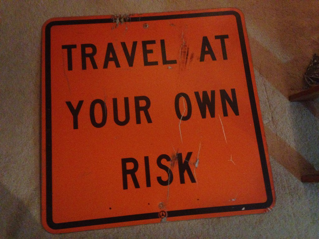 travel_at_your_own_risk_sign_by_patyler1-da9mu34